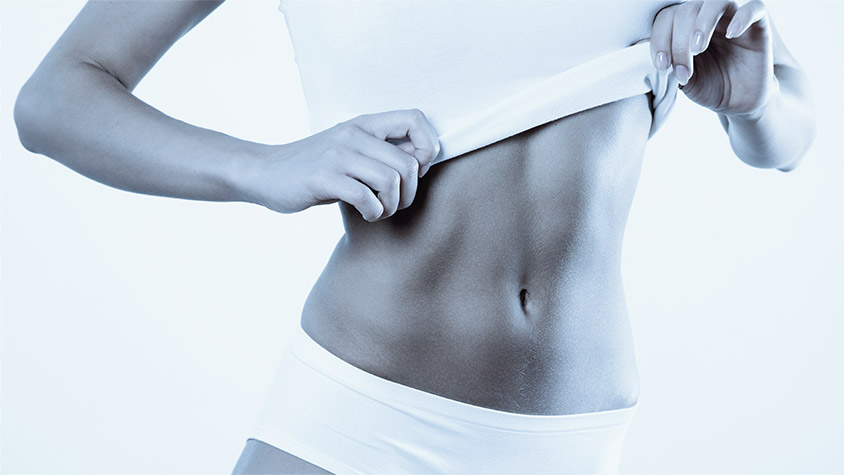 Women's flat stomach after a slimming treatment