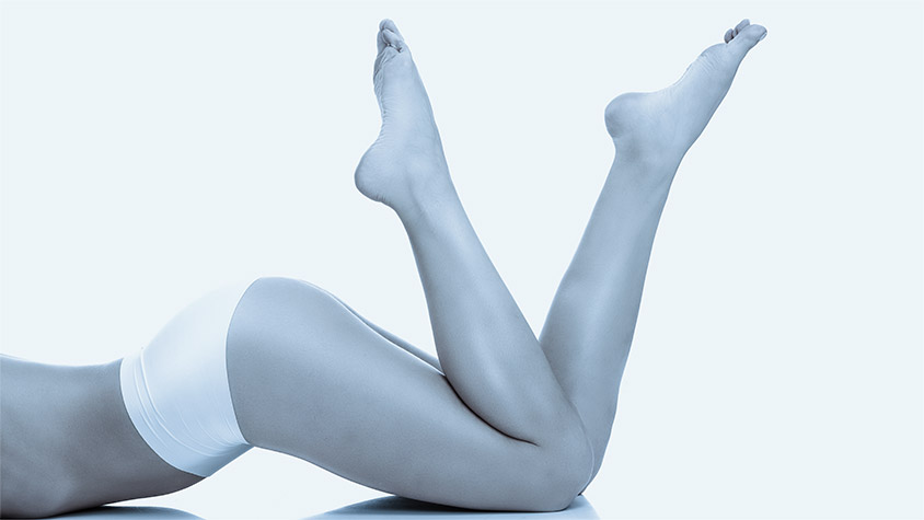 Legs, buttocks and women's perfect skin after body treatment